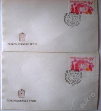 2 x razítko dívčí obličeje a znak Spartakiáda 1975