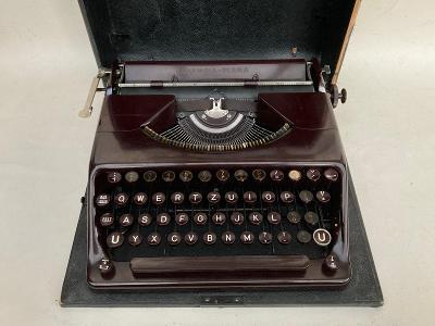 Starý kufříkový psací stroj OLYMPIA PLANA