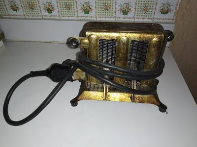 Starý kovový toustovač