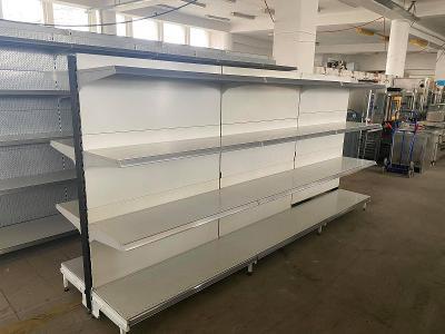 Prodám použité kovové obchodní oboustranné regály