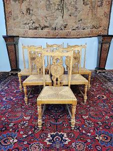 Jídelní židle zdobené figurálními řezbami