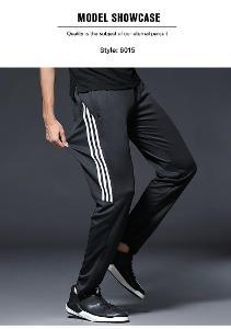 Pánské sportovní kalhoty - tepláky 4XL. - černé se zlatými pruhy 5537.