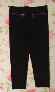 Kalhoty elastické  vel. 116
