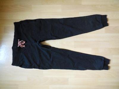 dámské Crivit černé tepláky pumpky,kapsy , nižší elast. 40/M