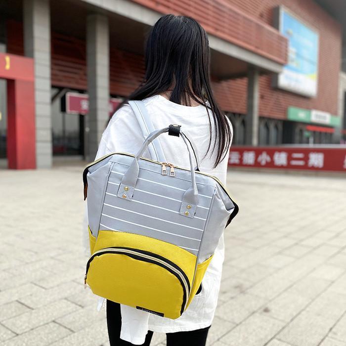 Pruhovaný batoh s barevnou kapsou 342 - Tašky, batohy, kufry