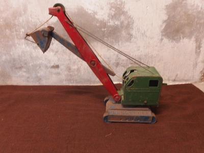 *+* Starožitný kovový obr bagr - 1956