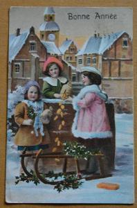Pohlednice Nový rok - děti - sáně - peníze - cesmína - kostel - 1912