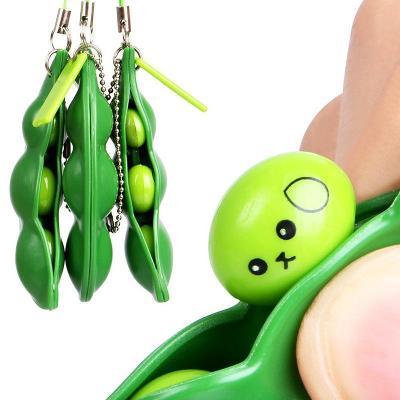Squishy zelený hrášek, fazole antistresová hračka pop it 0063