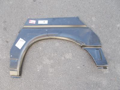 * VW Transporter T4  rv.09/1990-   levý zad. lem blatníku /krátký mod/