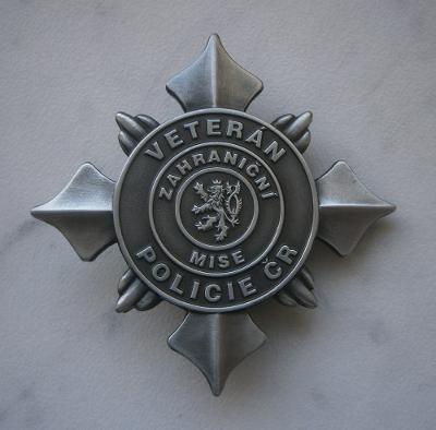 Odznak Policie ČR pčr plaketa veterán medaile vyznamenání řád EU lev