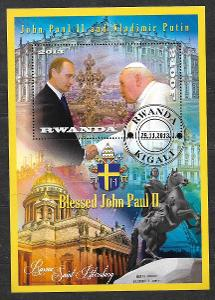 Rwanda - papež Jan Pavel II. a Putin