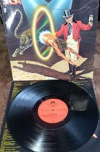 LP Saga  – Heads Or Tales NM-/EX-