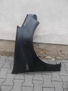 Dacia SANDERO r.v.08-12 pravý přední blatník bez otvoru pro lištu